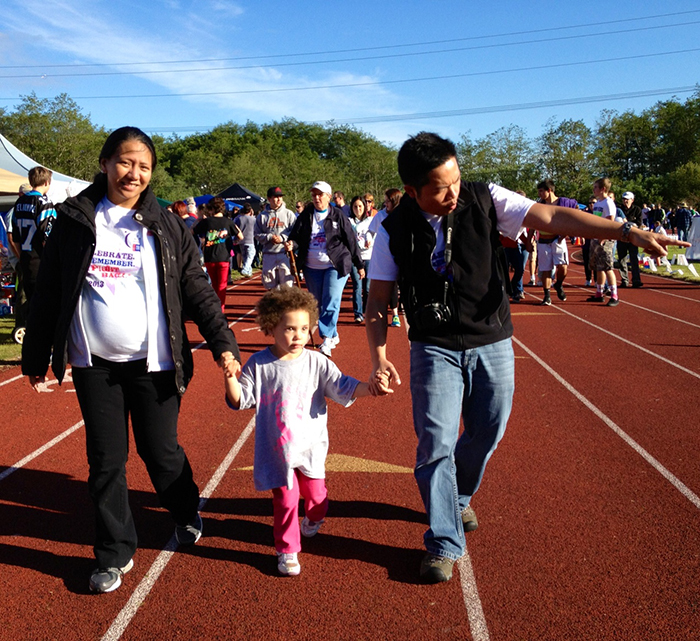 Margaret and Loupel walk with Nichole's daughter Abigail